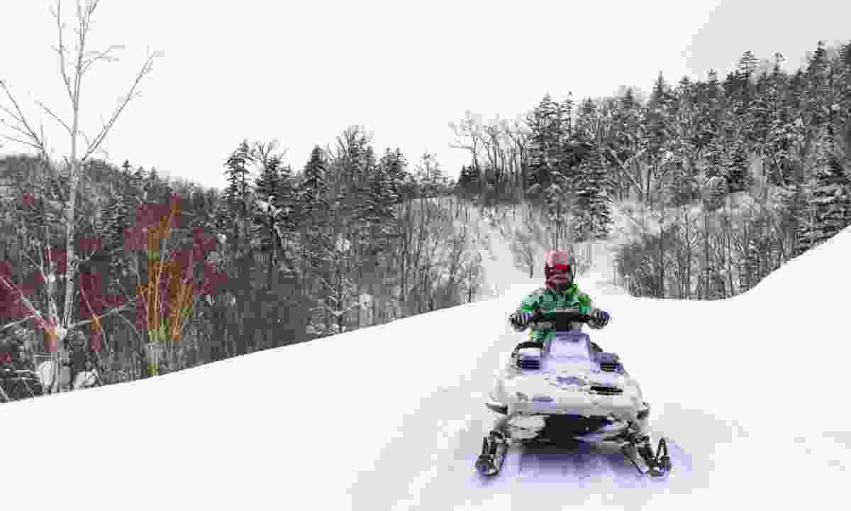 Speeding through the forests by snow mobile (Graeme Green)