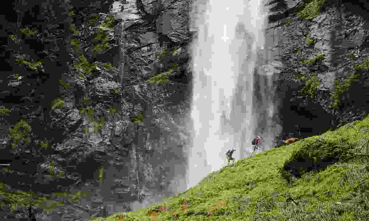 Hikers walk past Extew Falls in Terrace (Destination British Columbia/ Grant Harder)