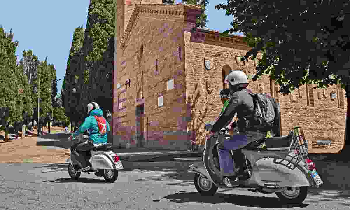 Vespa riders in Italy (Dreamstime)