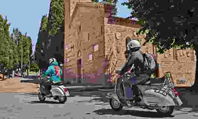 Vespa riders in Italy (Dreamstime)