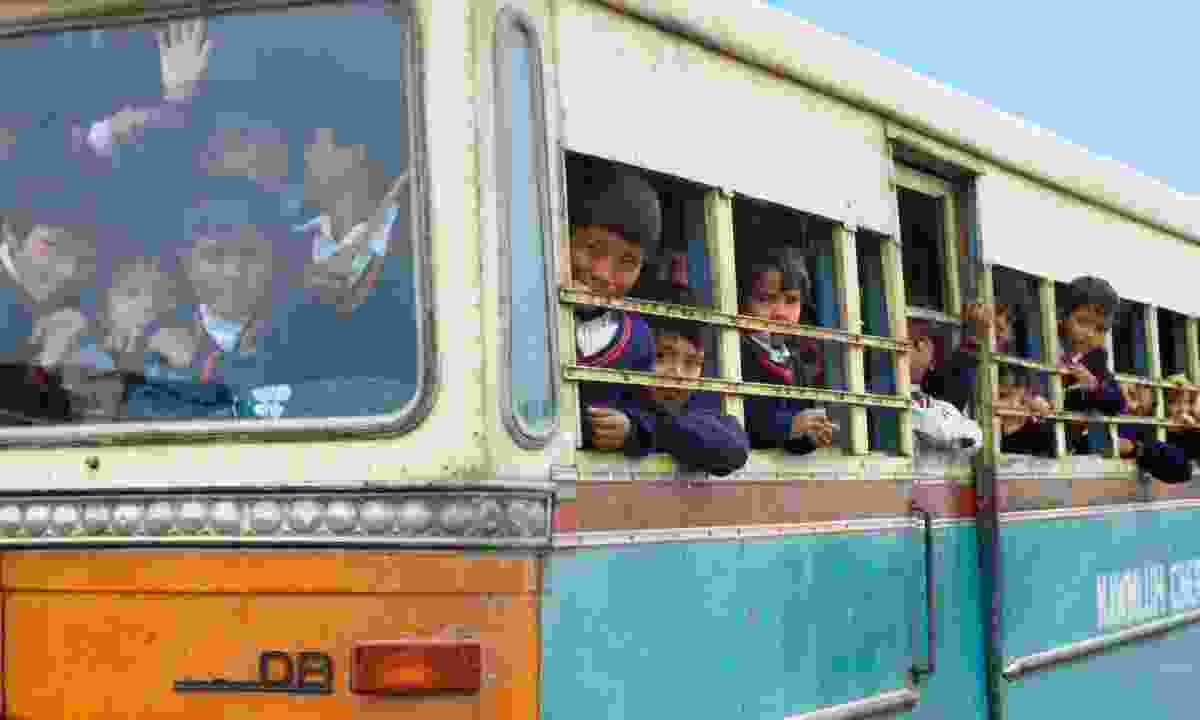 Crowded bus in Assam (Dreamstime)