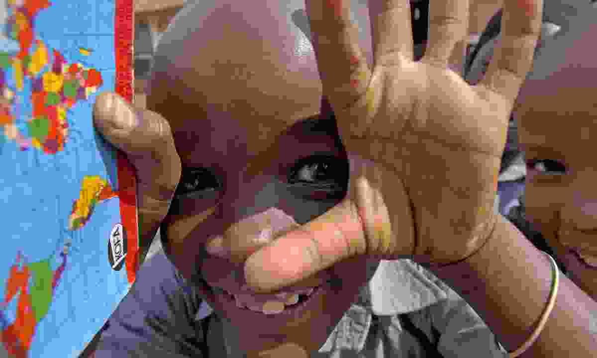 Happy kid in Kampala (Dreamstime)