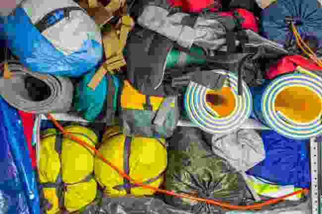 Camping gear stacked in a garage (Shutterstock)