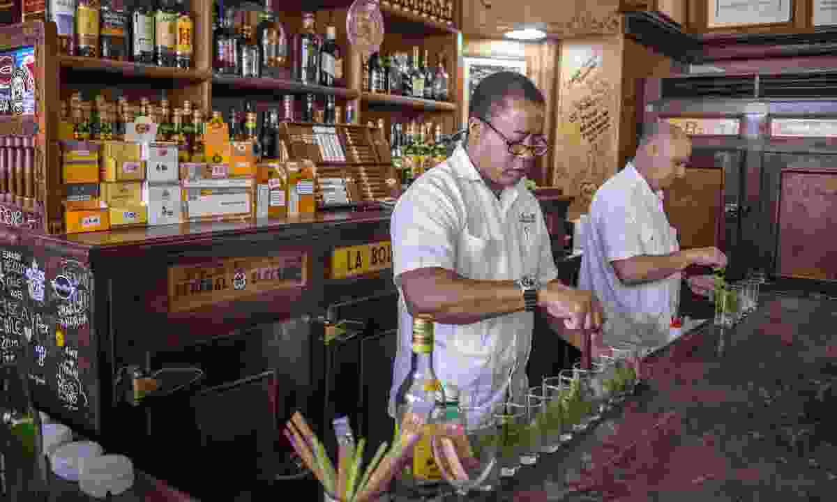 Preparing mojitos in Havana (Shutterstock)