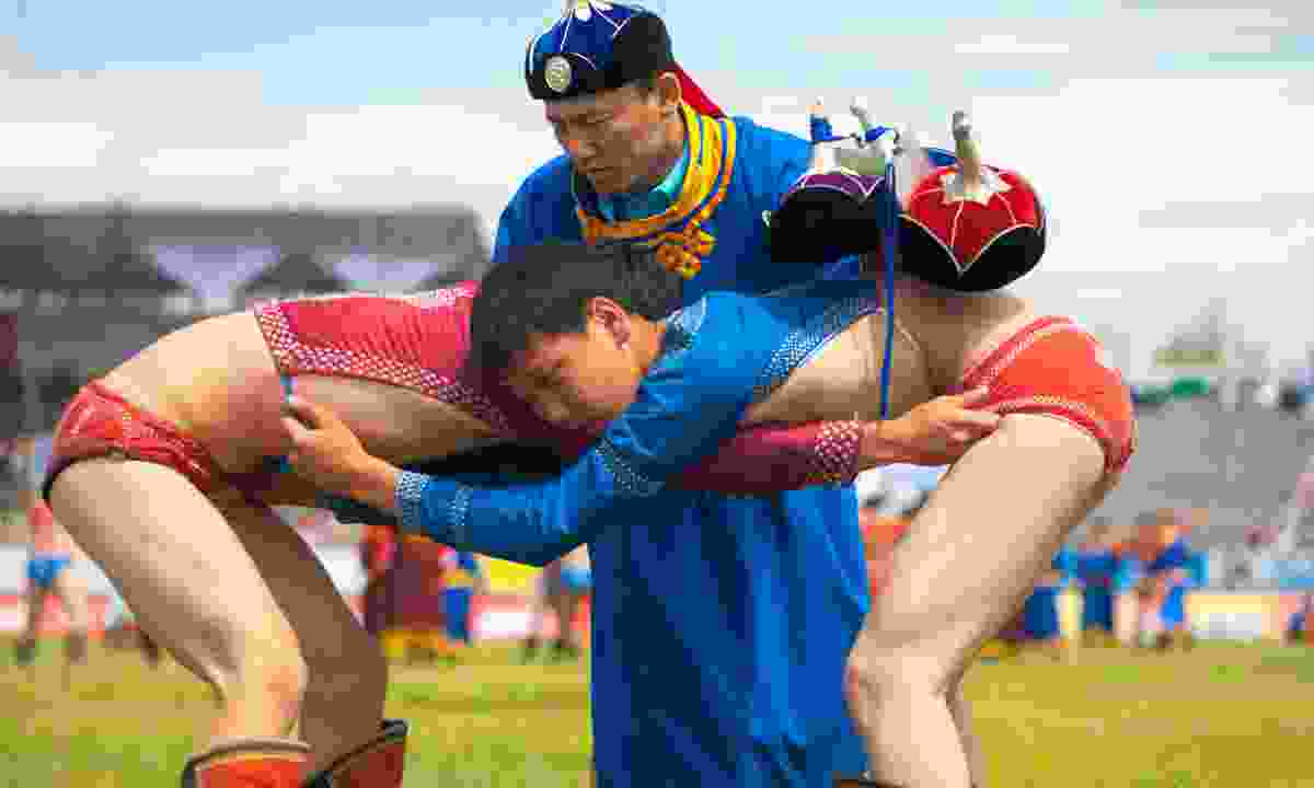 Wrestling during the Naadam Festival (Shutterstock)