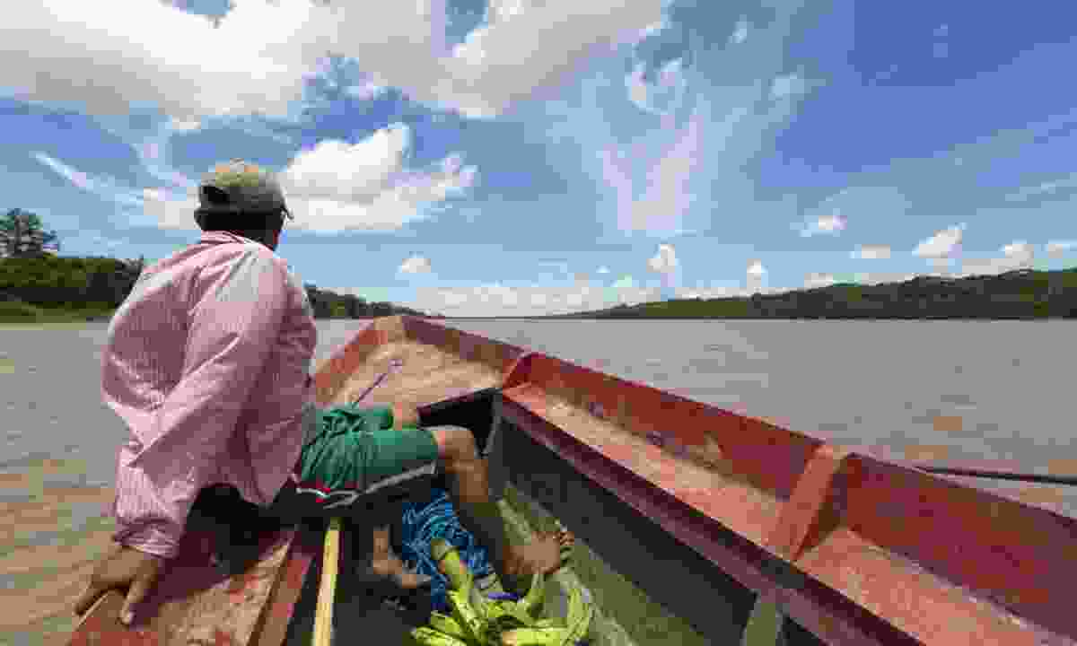 Travelling by boat along the Beni River in Bolivia (Dreamstime)