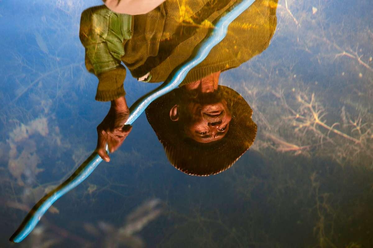 Reflection of a fisherman on Inle Lake, Burma (Steve McCurry)