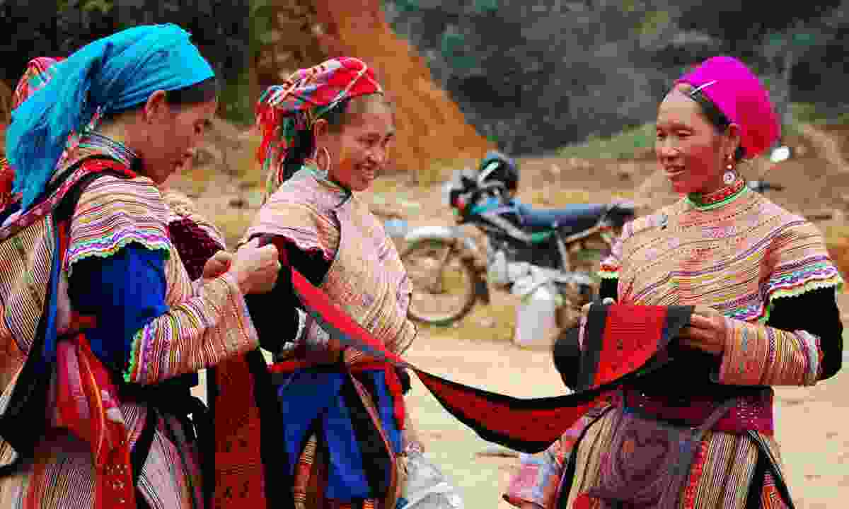 H'mong women at a market in Sapa (Dreamstime)