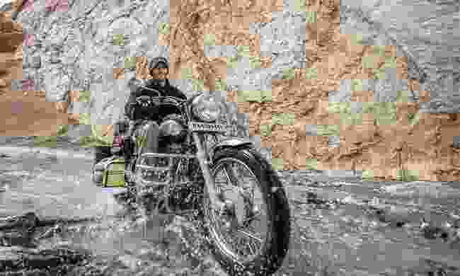 Riding a Royal Enfield in Ladakh, India (Dreamstime)