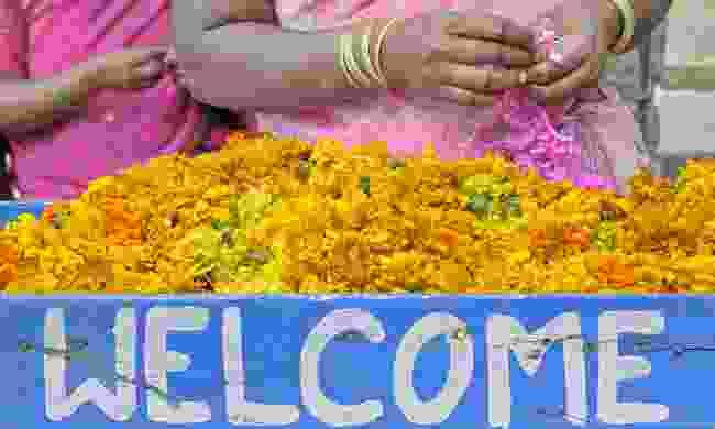 Women selling flowers in an Indian market  (Dreamstime)