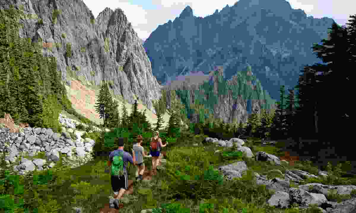 Three Hikers on a mountain Trail in Cascade Mountains (Shutterstock)