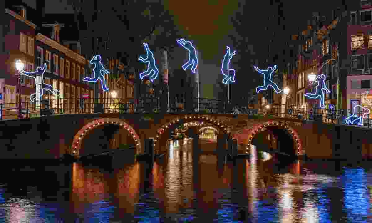 A light figure somersaults across a bridge Amsterdam (Shutterstock)