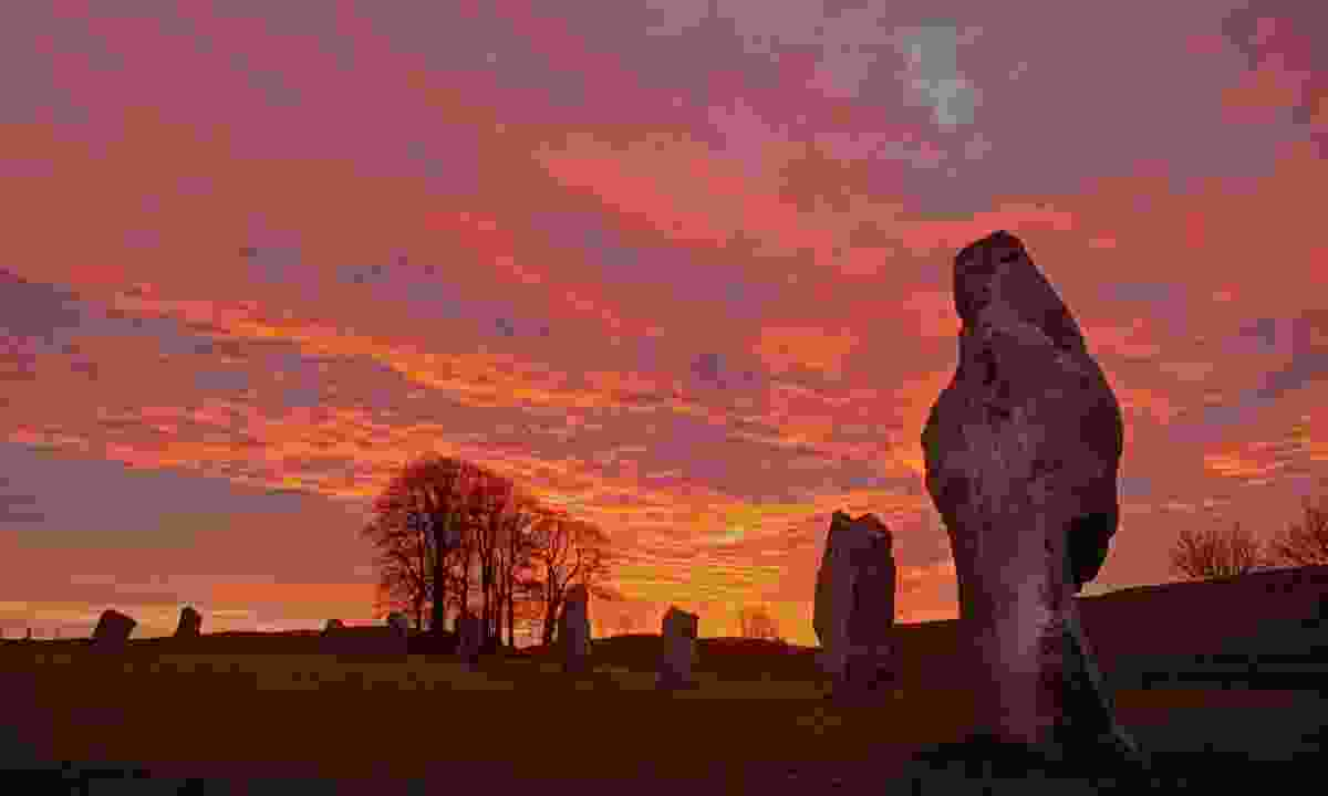 Avebury stone circle at sundown (Dreamstime)