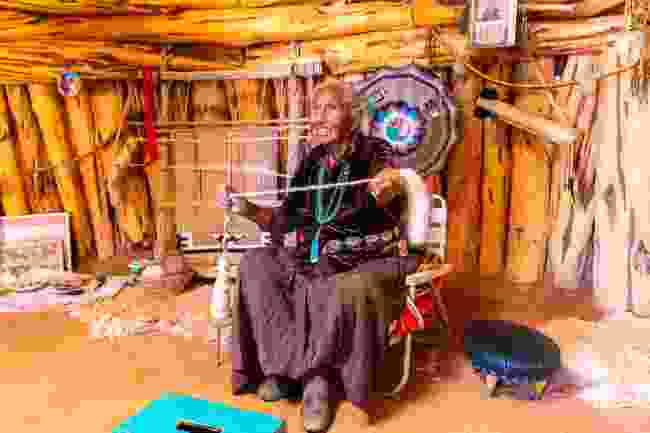 A Navajo woman spinning wool in Monument Valley, Arizona, USA (Shutterstock)