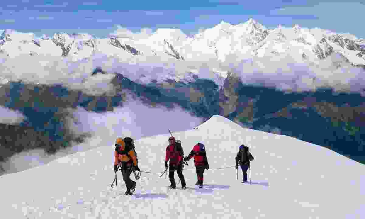 Reaching the summit of Weissmies (Shutterstock)