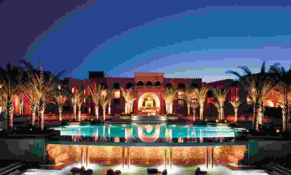 Al Husn Hotel infinity pool at night (Shangri-La)