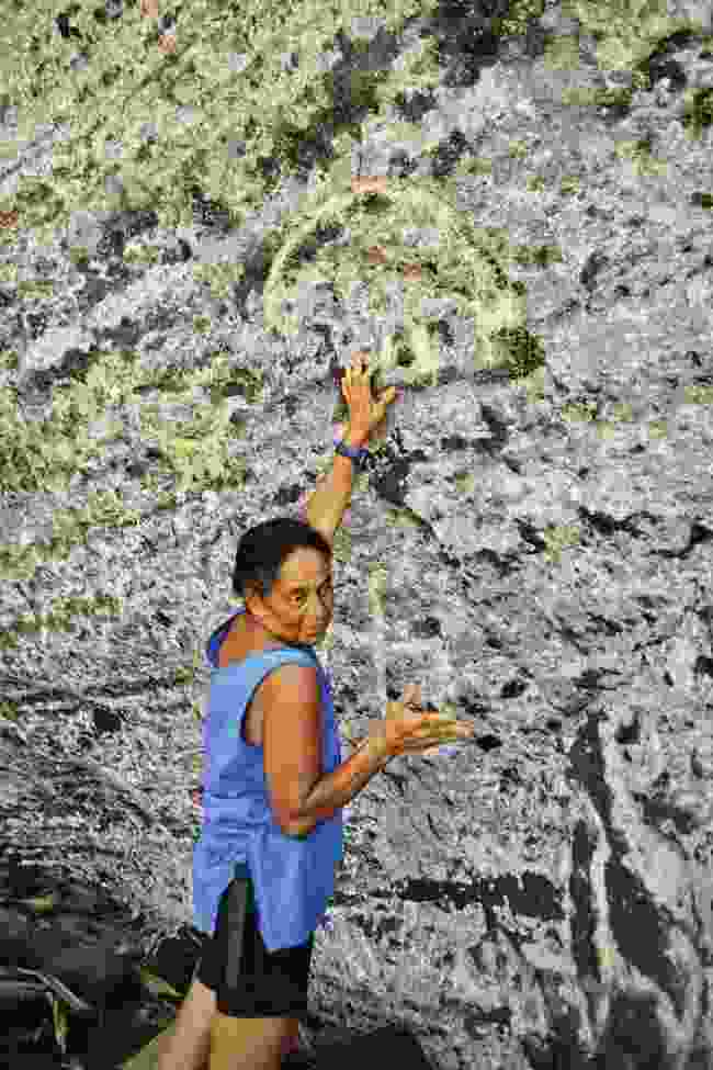 Brenda Christian shows off the island's petroglyphs (Mark Stratton)