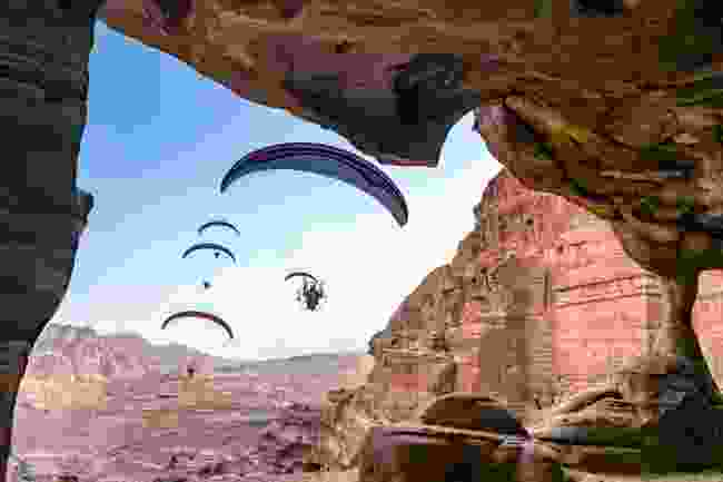 The paramotor team fly make a close pass of the ruins at Petra, Jordan (Fergus Kennedy)