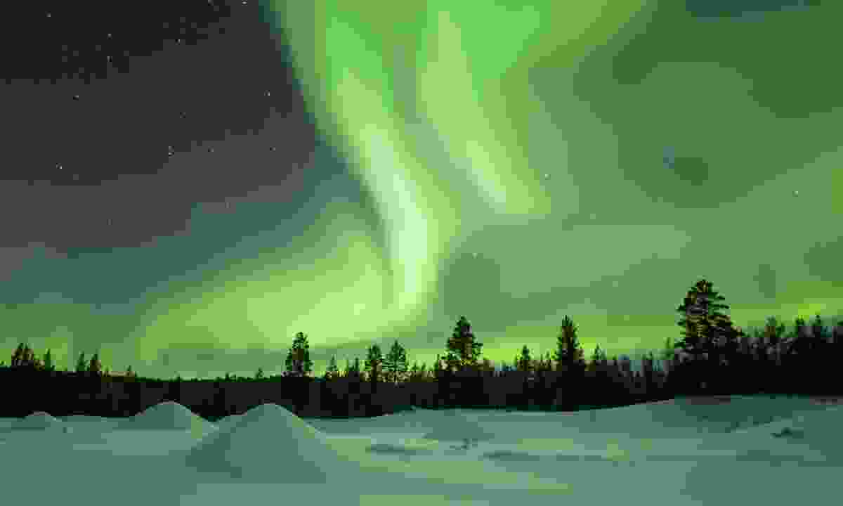 Delight in the planet's most dazzling spectacles, such as the northern lights in Finland (Dreamstime)