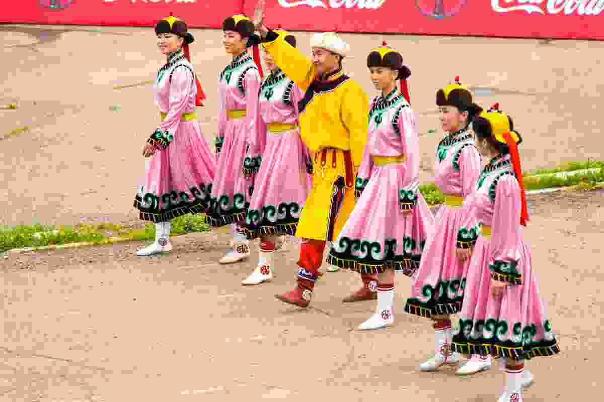 Women dressed in pink, at the opening ceremony of Naadam in Ulaanbaatar, Mongolia (Shutterstock)