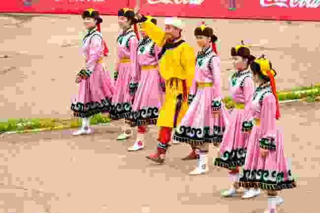 Women dressed in pink, at the opening ceremony of Naadam in Ulaanbaatar, Mongolia (Shutterstock)