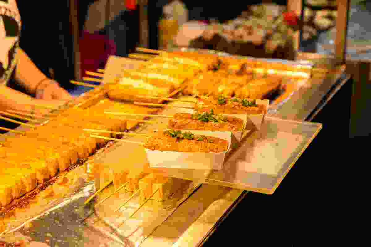 Stinky fermented tofu with hot sauce is a popular street food snack in Taiwan (Shutterstock)
