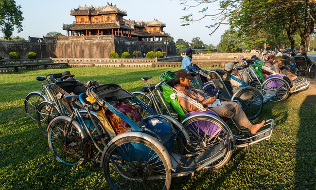 Cyclo drivers in Hue (Dreamstime)