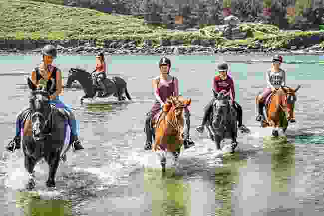 Horseriders crossing a river on the Isles of Scilly (Wanderlust)