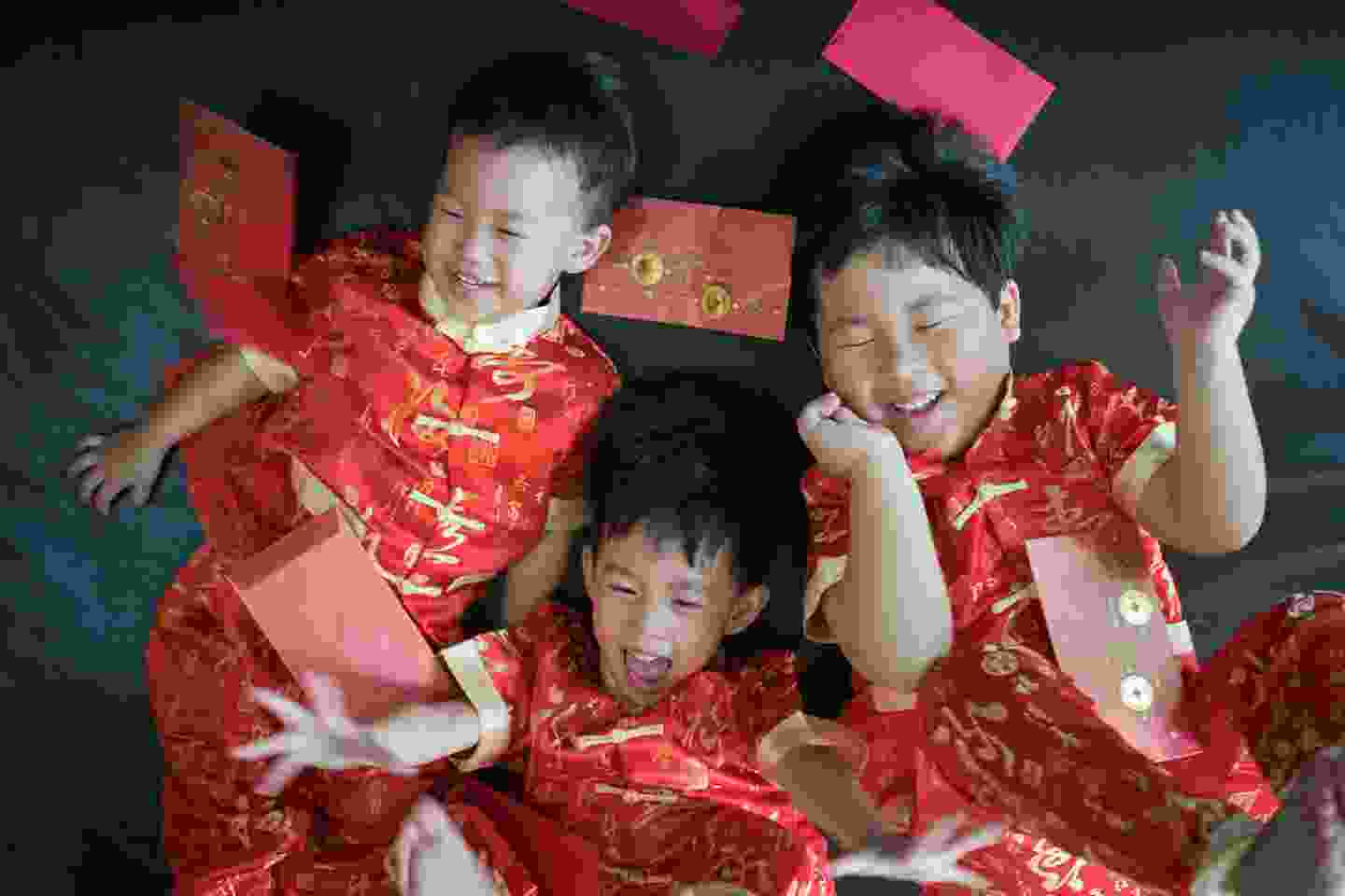 Children receiving gifts on New Year (shutterstock)
