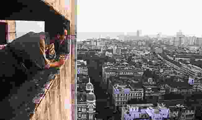 Looking out over Bombay (Mumbai) from the top of a rough extension to its Taj Mahal hotel, where Palin found himself after a seven-day journey on a fishing dhow across the Persian Gulf (Julian Charrington)