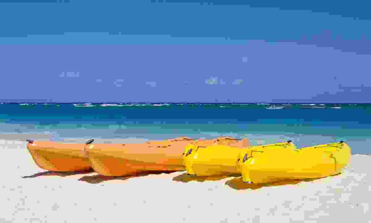 Kayaks on an Antiguan beach (Dreamstime)