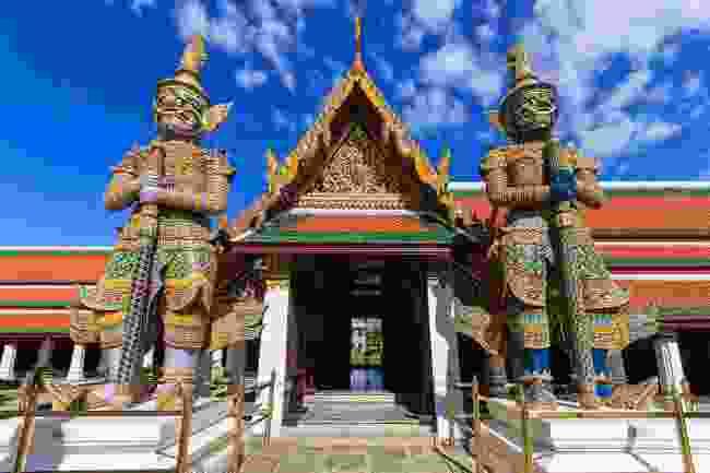 Mosaic-covered demons guarding Wat Phra Kaew in Bangkok, Thailand (Shutterstock)