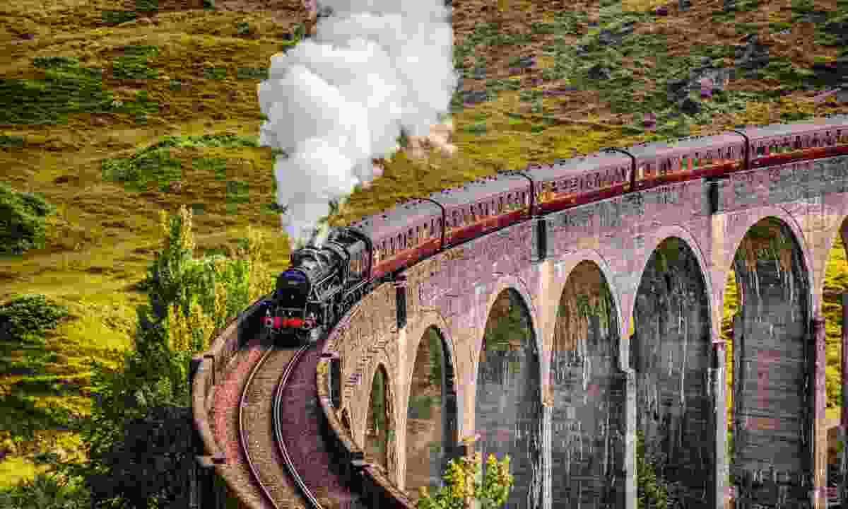 The Jacobite, crossing Glenfinnan viaduct (Dreamstime)