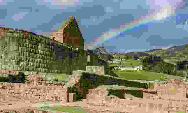A rainbow shines above the Temple of the Sun with rainbow at the famous Inca ruins of Ingapirca (Shutterstock)