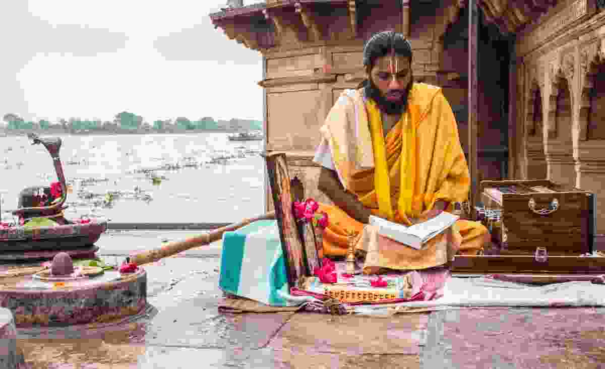 Sadhu reading scriptures on banks of Yamuna river, Vrindavan (Dreamstime)