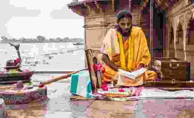 Sadhu reading scriptures on banks of Yamuna river, Vrindavan (Dreamstime)