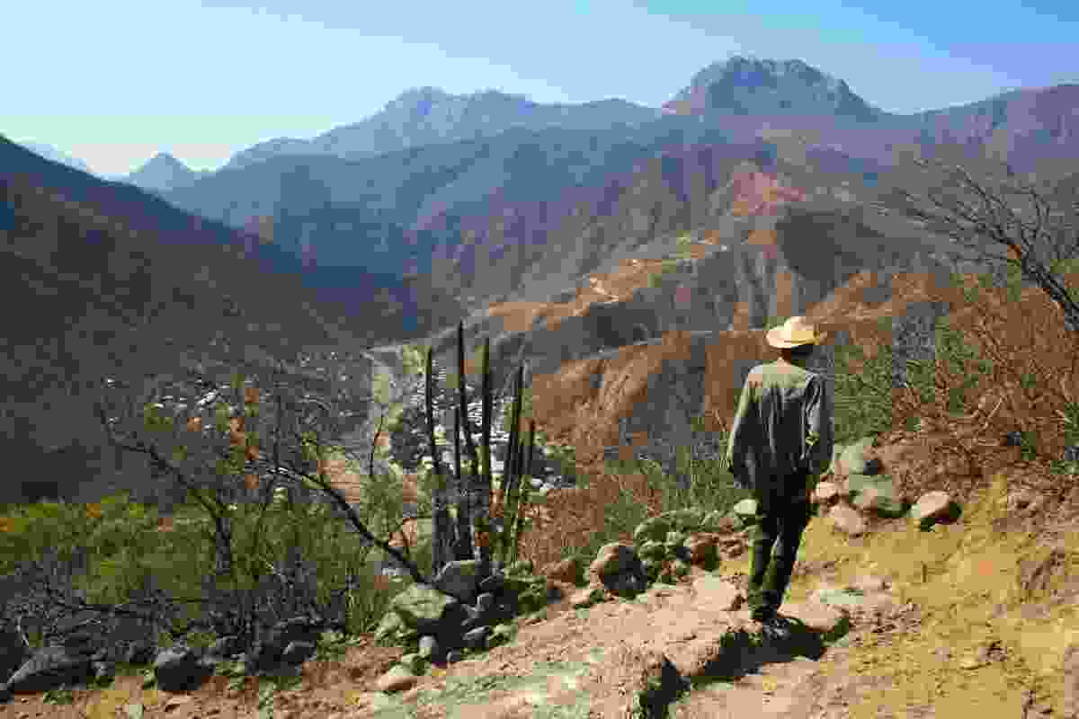 Silver miner walking through Mexico's Copper Canyon (Graeme Green)