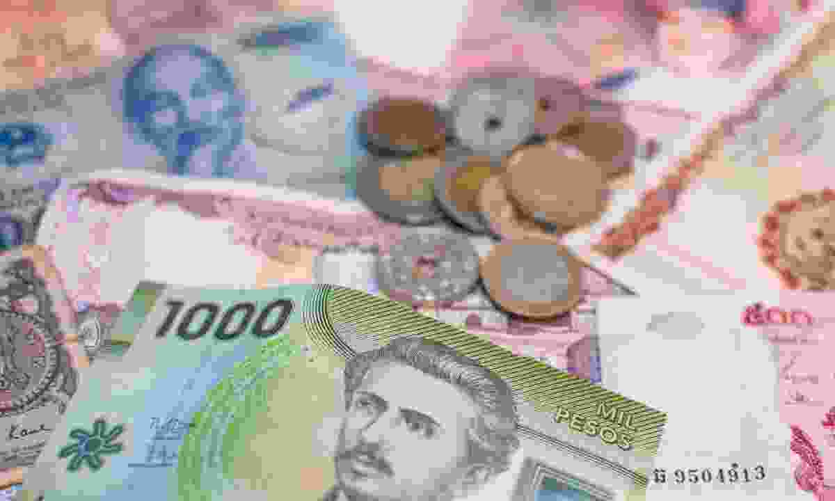 A mixture of world currencies (Dreamstime)