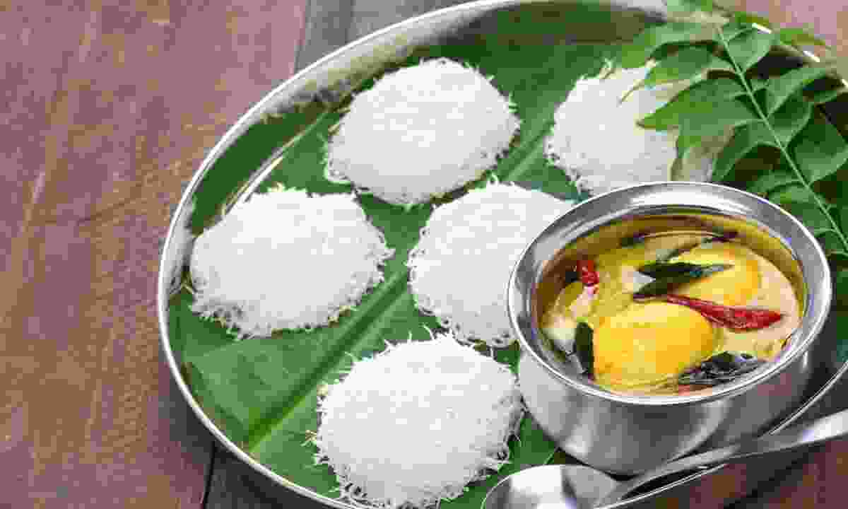 Idiyappam with egg curry (Dreamstime)