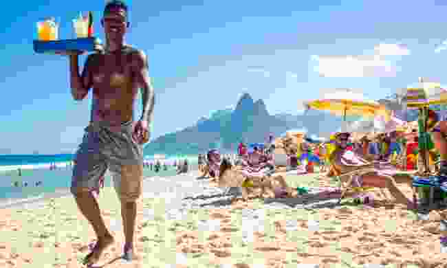 A beach vendor selling homemade caipirinha cocktails on Ipanema Beach (Shuttertsock)