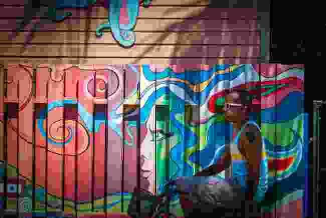 Cyclist in Placencia Village, Belize. (Dreamstime)