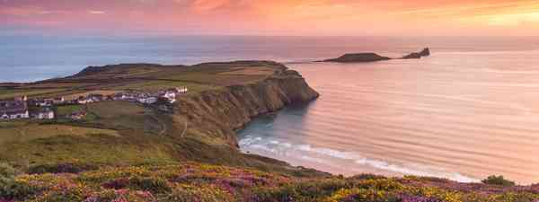 Sunset and heather at Rhossili Bay overlooking Worm's Head (Drew Buckley)