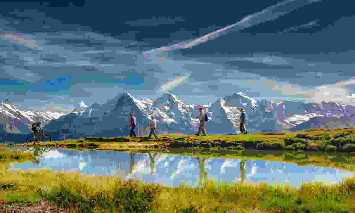 Hikers in Bernese Oberland (Shutterstock)
