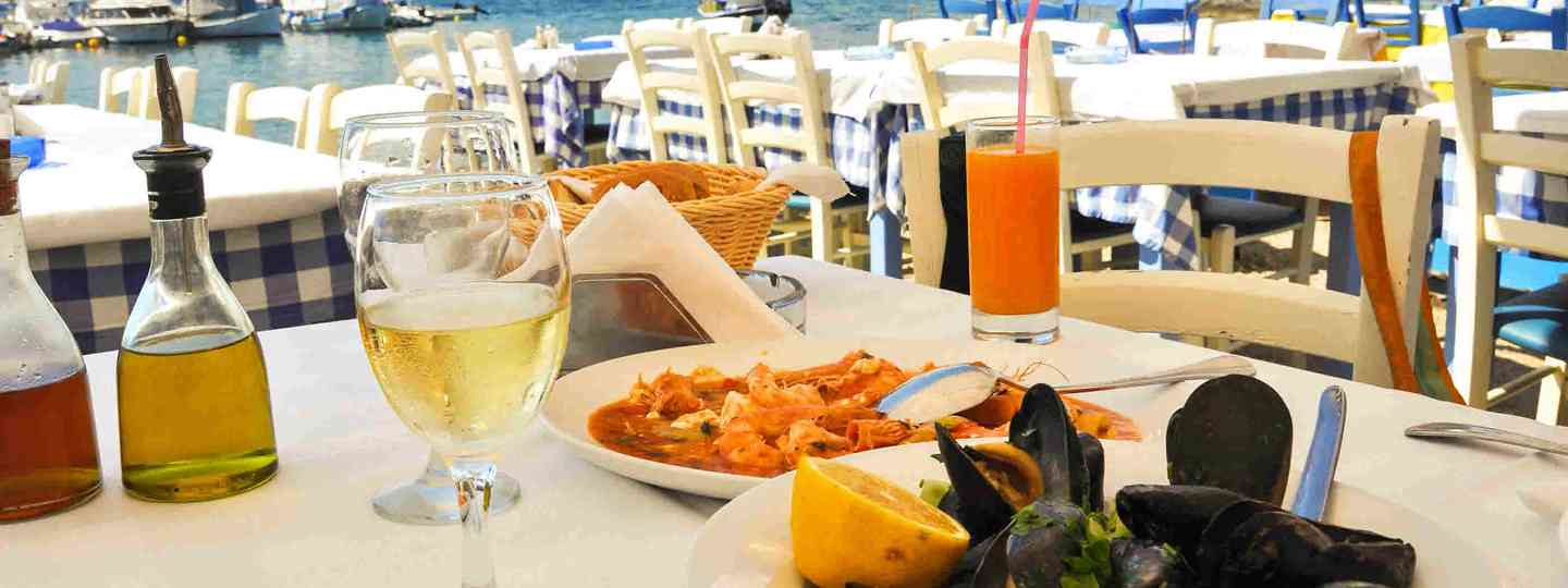 Seafood dinner in a Greece restaurant (Shutterstock)