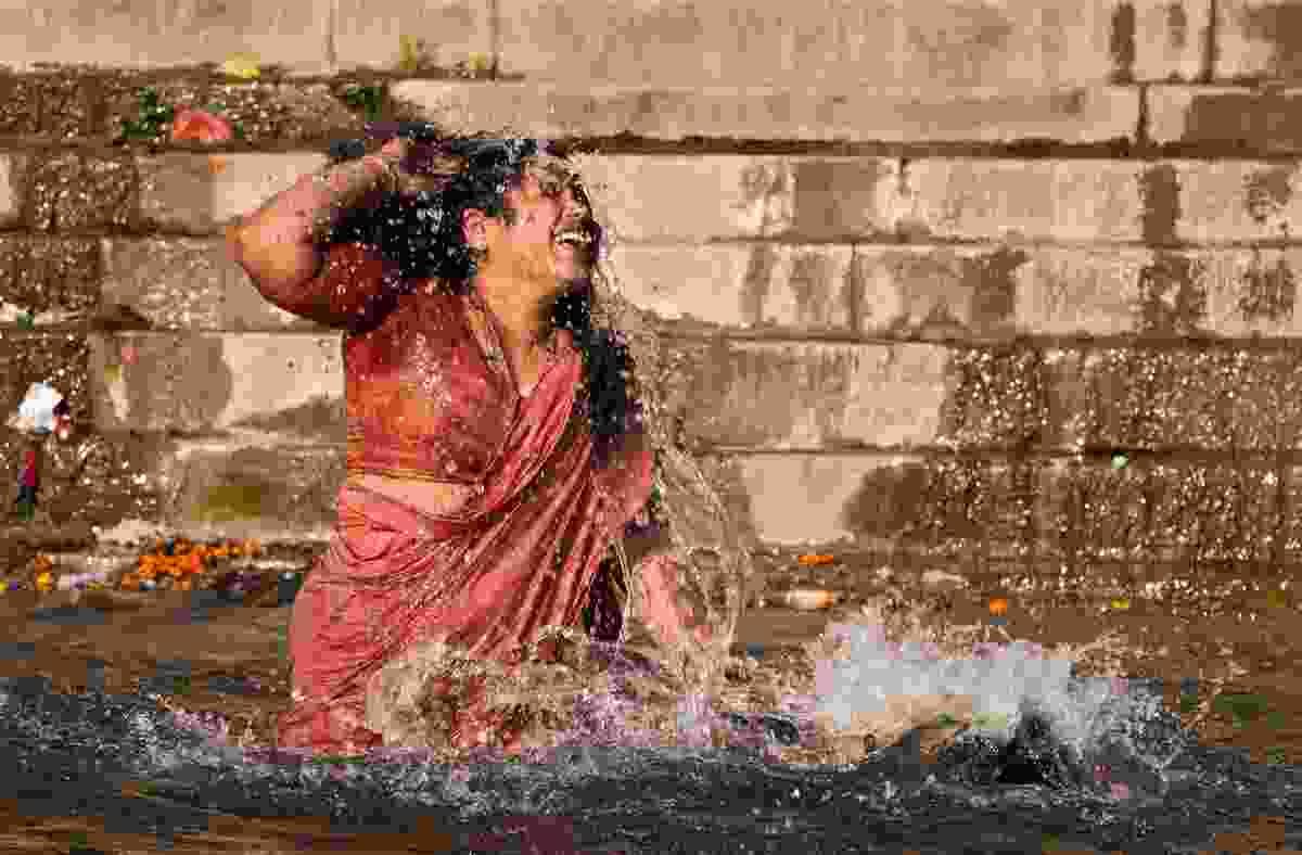 Woman takes a holy bath for Maha Shivaratri. (Dreamstime)
