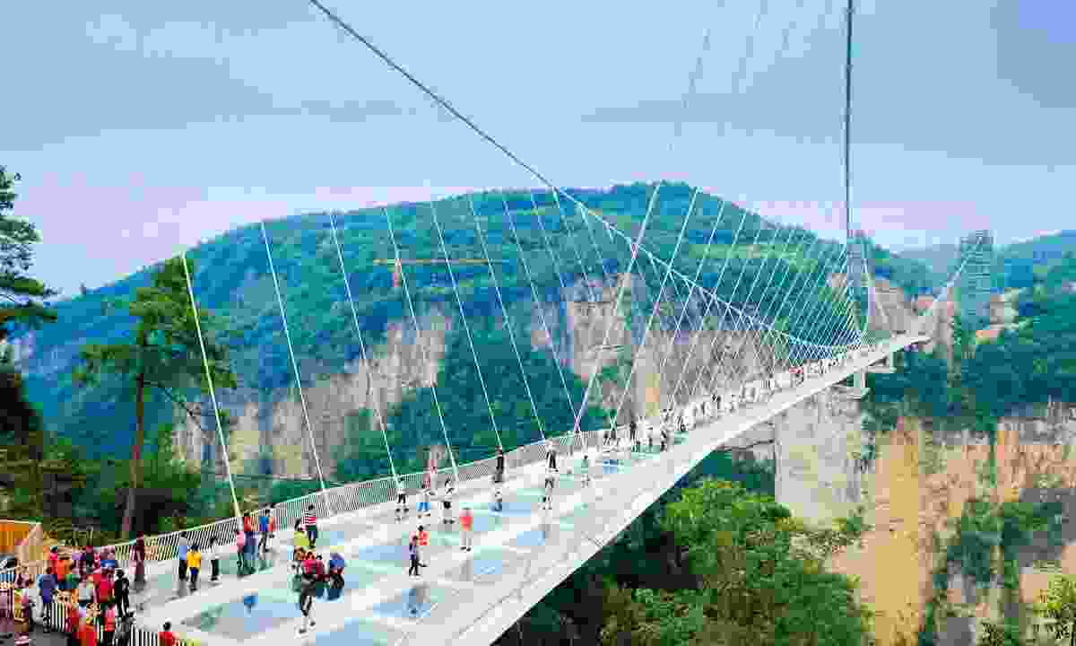 Push your limits for the most memorable experiences – you could walk one of China's glass suspension bridges (Shutterstock)