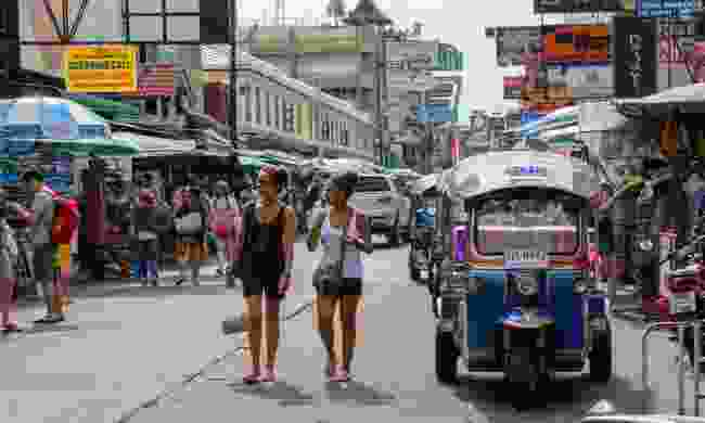 Tourists walk along Khao San Road (Dreamstime)