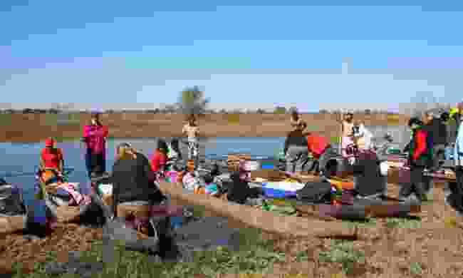 Tourists with canoes,  Okavango Delta, Botswana (Dreamstime)