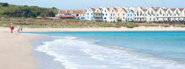 Strolling along the sands of Braye beach (Simon Chubb)