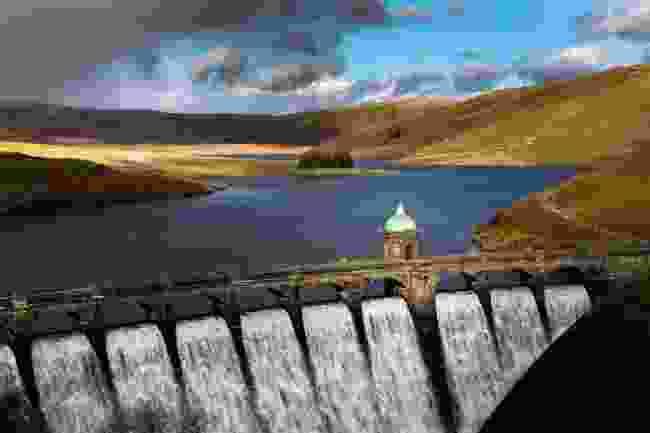Craig Goch Dam, in between sleet showers, with its falls flowing (Drew Buckley)